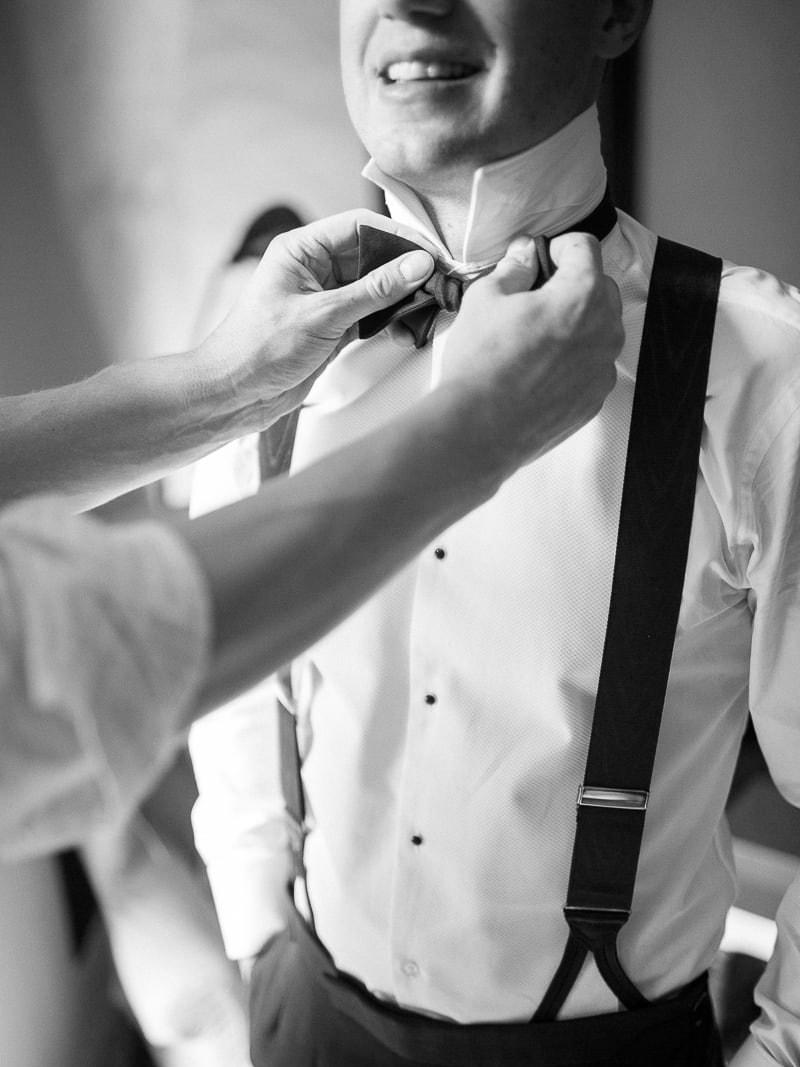 The groom's preparations for the Wedding at Chateau de Bagnols with a Gatsby theme.