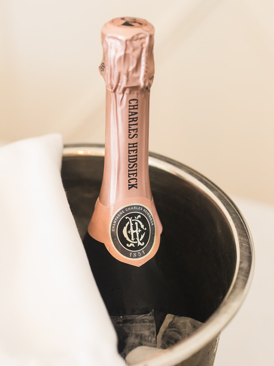 A detail of a bottle of champagne during a wedding in France.