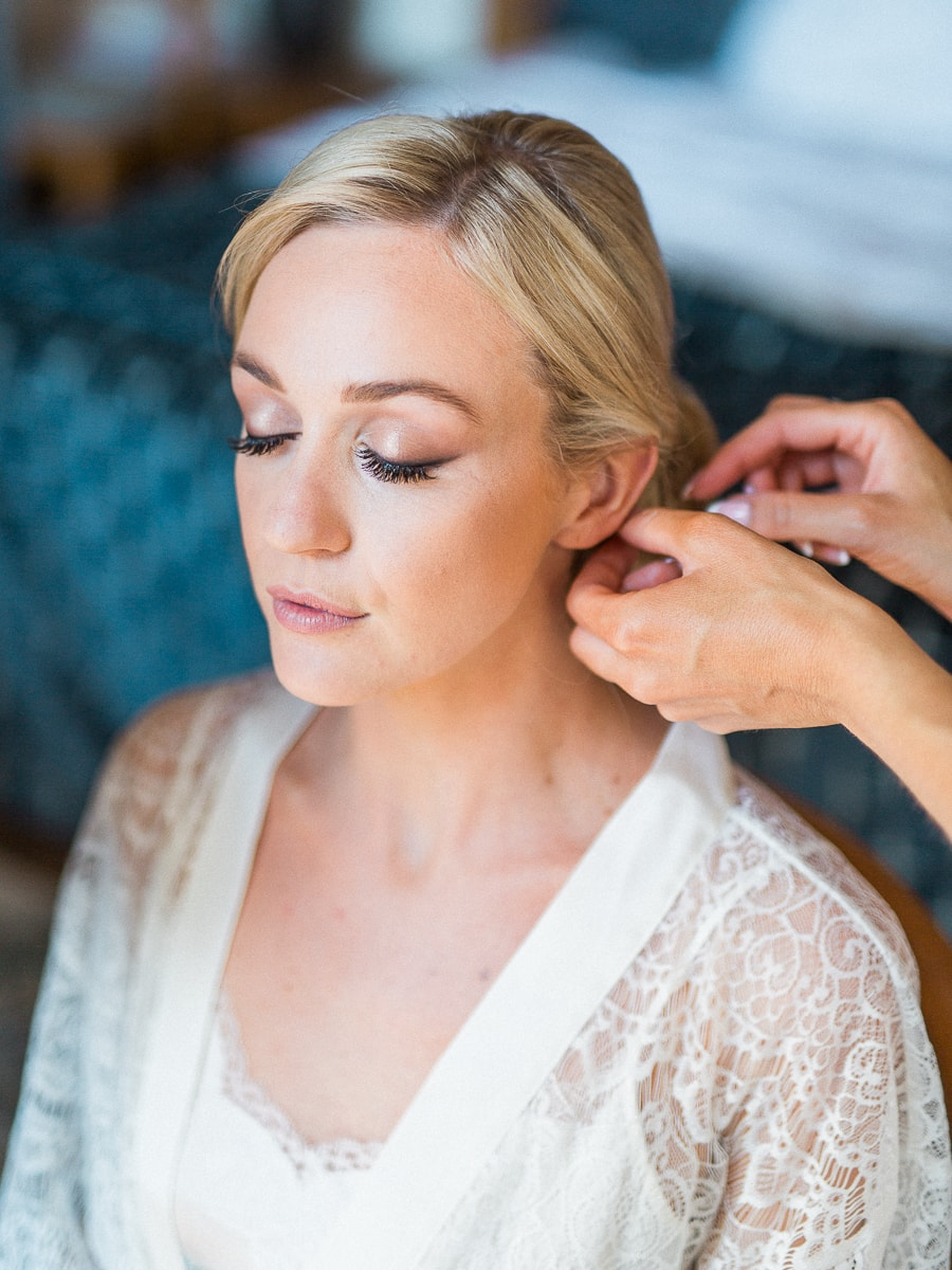 A portrait of a beautiful bride during preparations in Monaco on the French Riviera by Sylvain Bouzat.